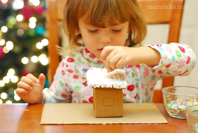Girl-decorating-gingerbread-house