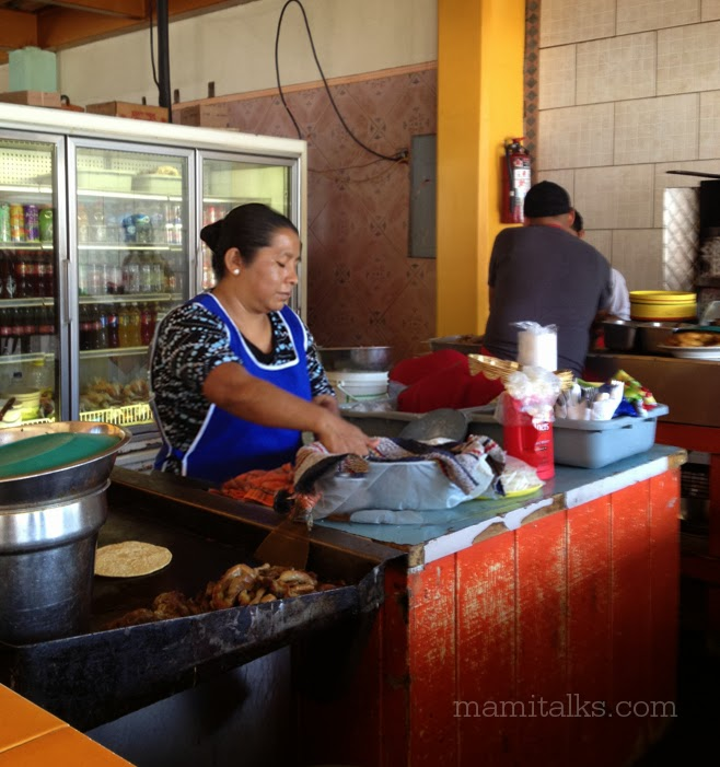 Lady cooking at Mexican restaurant