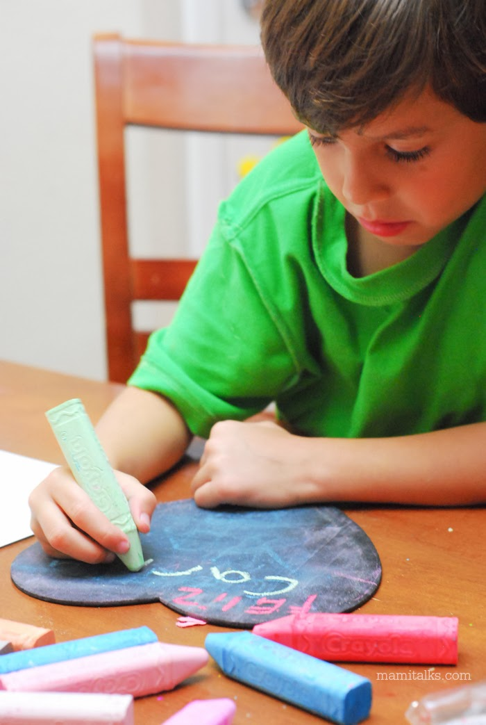 Little boy using chalks. -MamiTalks.com