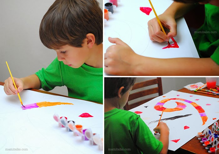 boy painting a poster. -Mamitalks.com