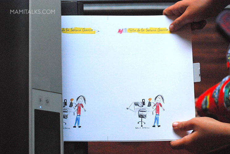 Kid getting personalized notes from the printer. -MamiTalks.com