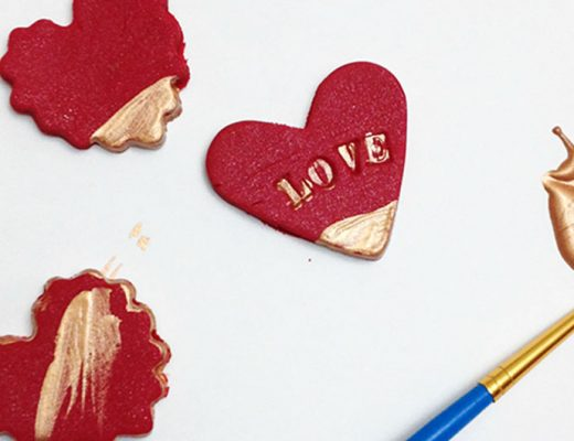 DIY clay magnets valentines showing paintbrush with gold paint.-MamiTalks.com