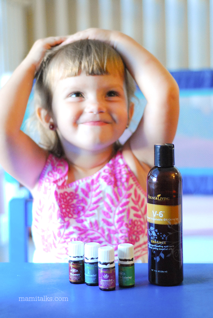 little-girl-using-essential-oils-mamitalks