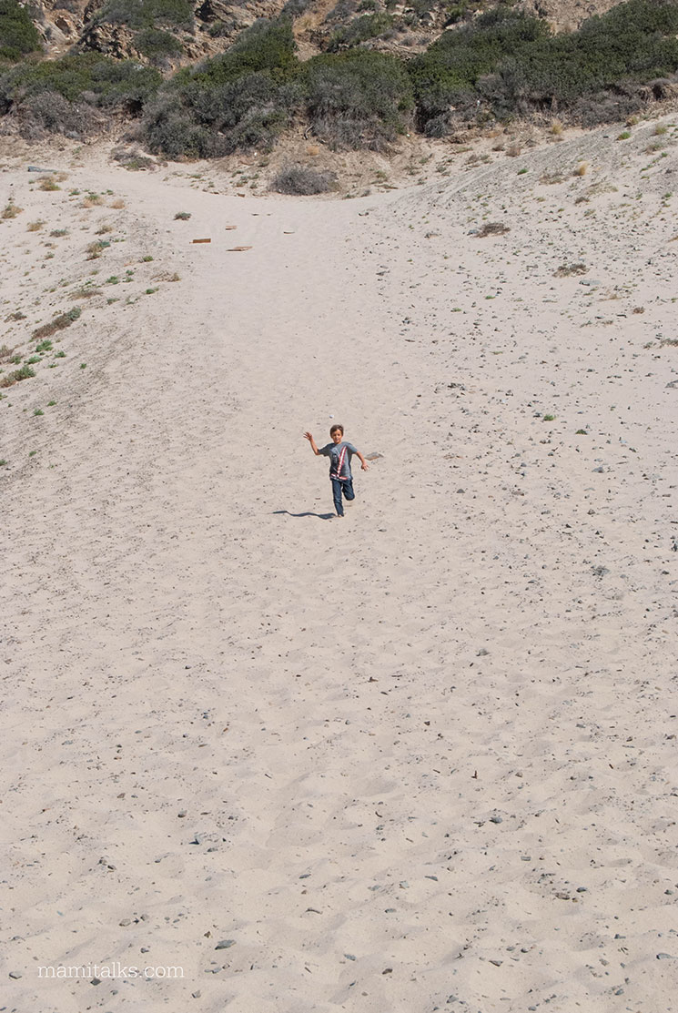 kid running down the Sand Dunes by the beach at Malibu -MamiTalks.com
