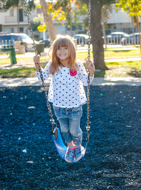 girl-standing-on-a-swing-mamitalks