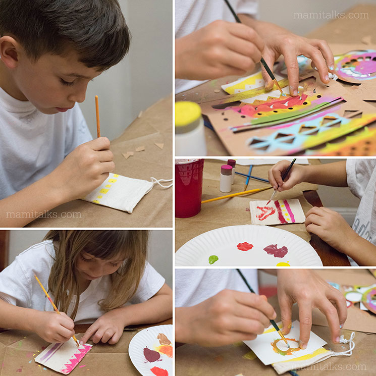Several pictures of kids painting treat bags for Valentine's Day. -MamiTalks.com