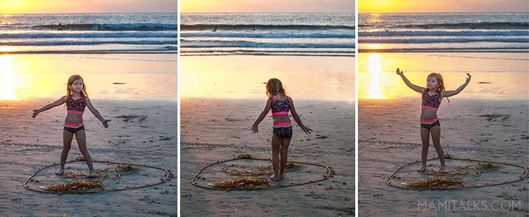 Girl playing with seaweed in La Jolla -MamiTalks.com