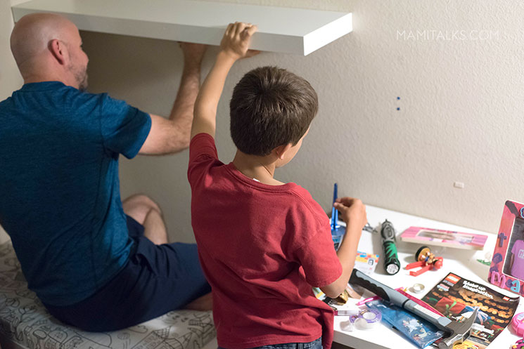 Dad and son helping take down shelves -MamiTalks.com