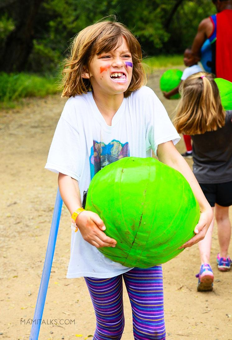 Girl lifting heavy ball. mamitalks.com