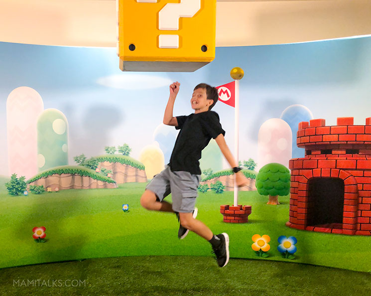 jumping like Mario at Nintendo event. MamiTalks.com