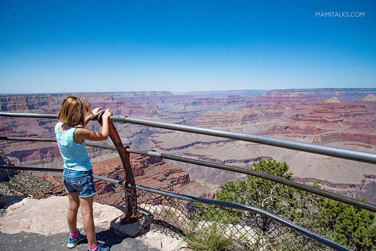 Hopi Point view at the South Rim Grand Canyon, girl looking out. -MamiTalks.com