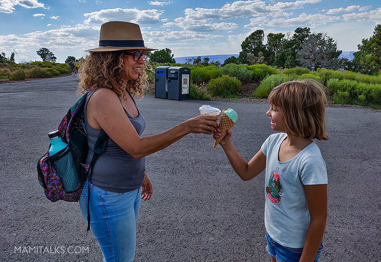 Mom and daughter eating ice cream in a park. Grand Canyon National Park. -MamiTalks.com