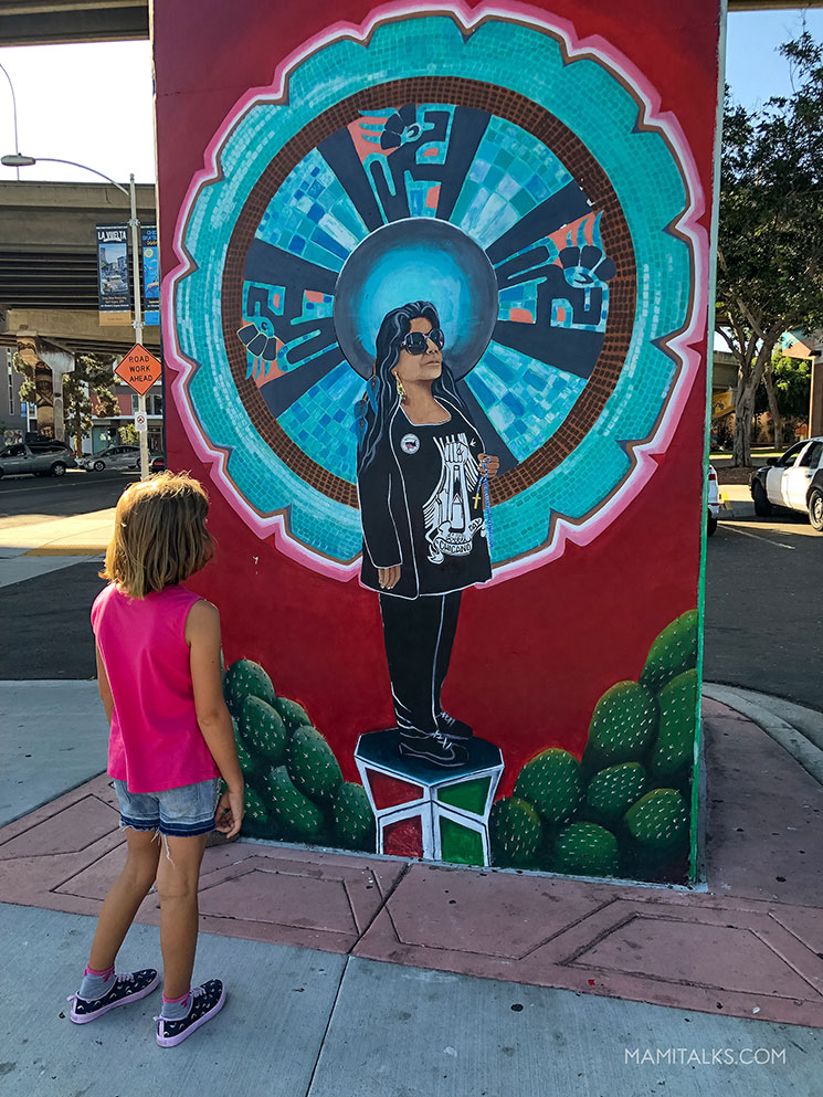 Girl looking at art in San Diego chicano Park. -MamiTalks.com