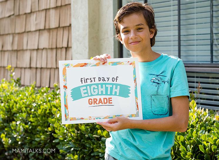 Boy holding first day of school sign. MamiTalks.com