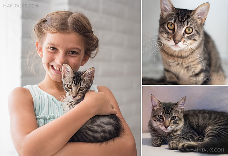 Girl holding cat. -Mamitalks.com
